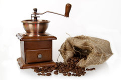 Coffee mill with burlap sack of roasted beans Stock Images