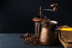 Coffee mill and cezve on the dark table horizontal Stock Photography