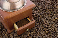 Coffee mill on coffee beans Royalty Free Stock Photos
