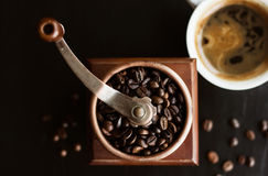 Coffee mill with coffee beans Royalty Free Stock Image