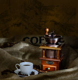 Coffee mill and cup Royalty Free Stock Image