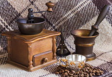 Coffee mill, cup and coffee beans. On background Royalty Free Stock Images