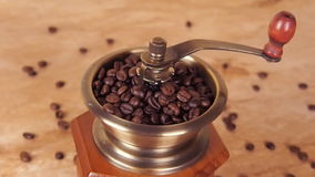 A coffee mill filled with coffee beans. Coffee grinder with coffee beans. stock video footage