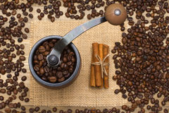 Coffee mill full coffee beans Royalty Free Stock Photo