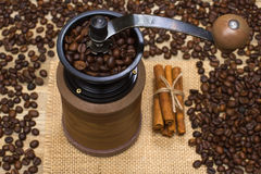 Coffee mill full coffee beans on sackcloth Royalty Free Stock Images