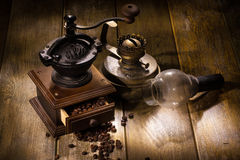 Coffee Mill And Old Oil Lamp Royalty Free Stock Photo