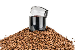 Coffee mill and pile of coffee beans - Isolated Royalty Free Stock Photography