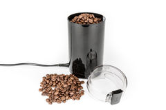 Coffee mill and pile of coffee beans - Isolated Stock Photos