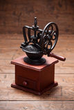 Coffee mill on rustic old wooden table Stock Images