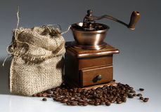 Coffee mill with a sack of roasted beans Royalty Free Stock Images