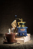 Coffee mill. Vintage coffee mill, coffee beans and cup of coffee Stock Photo