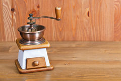 Coffee mill on wooden table Royalty Free Stock Photo
