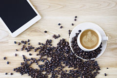Coffee and mini tablet Royalty Free Stock Photos