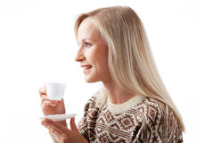 Coffee minute. Profile of blond female looking afar while having coffee minute Stock Photo