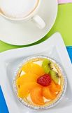 Coffee and mixed fruit pie. Coffee and colorful mixed fruit pie royalty free stock photography