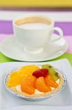 Coffee and mixed fruit pie. Coffee and colorful mixed fruit pie stock image