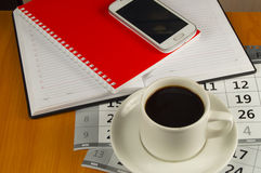 Coffee, mobile phone, diary and my red notebook on the desktop. Space for text Royalty Free Stock Photos