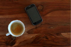 Coffee and Mobile Phone on the wooden table Royalty Free Stock Photo