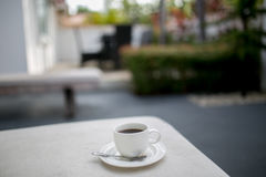 Coffee and MobilePhone on a Chair with pool in resort Stock Photos