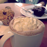 Coffee mocha with cream and blueberry muffin - vintage effect. Royalty Free Stock Image