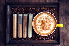 Coffee mocha hot and coffee beans on wooden table Stock Images