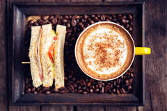 Coffee mocha hot and sandwiches on wooden table Stock Photo