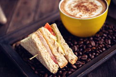 Coffee mocha hot and sandwiches on wooden table Stock Images