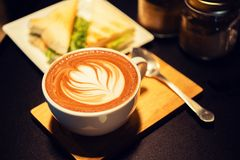 Coffee mocha hot on wooden table Royalty Free Stock Image