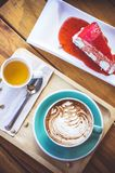 Coffee mocha lattee cup on wood table and cake relax time on caf. E shop Stock Image
