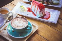 coffee mocha lattee cup on wood table and cake relax time on cafe shop stock image