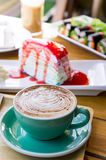 Coffee mocha lattee cup on wood table and cake relax time on cafe shop stock photography