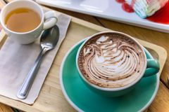 coffee mocha lattee cup on wood table and cake relax time on cafe shop royalty free stock images