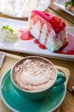 Coffee mocha lattee cup on wood table and cake relax time on cafe shop royalty free stock image
