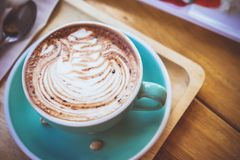 coffee mocha lattee cup on wood table and cake relax time on cafe shop stock photos
