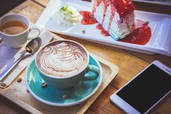Coffee mocha lattee cup on wood table and cake relax time on caf. E shop Royalty Free Stock Photography