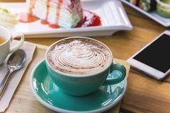 coffee mocha lattee cup on wood table and cake relax time on cafe shop stock images