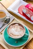 Coffee mocha lattee cup on wood table and cake relax time on cafe shop stock photo