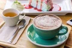 Coffee mocha lattee cup on wood table and cake relax time on cafe shop.  royalty free stock photos