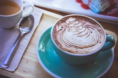 Coffee mocha lattee cup on wood table and cake relax time on caf. E shop Royalty Free Stock Image