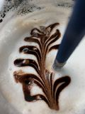 Coffee mocha with milk foam design topping Royalty Free Stock Image