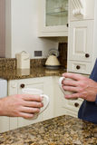 Coffee in modern kitchen Stock Images