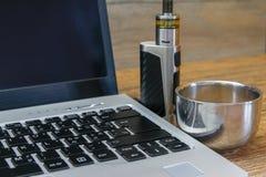 Coffee on modern laptop - ultrabook royalty free stock photo