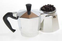 Coffee Moka on white. Italian moka with coffee beans on a white background Stock Image