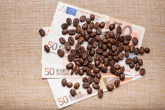 Coffee on money Stock Photography