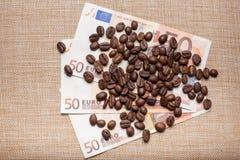 Coffee on money Stock Photography