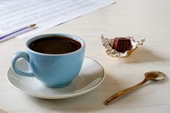 Coffee in the morning. A cup of coffee and chocolate Stock Photography