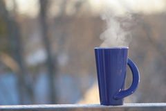 Coffee in the Morning. Hot Coffee on a cold Morning Royalty Free Stock Photos