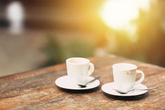 Coffee in the morning, two cup of espresso on wood table Royalty Free Stock Image