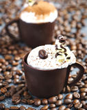 Coffee mousse with whipped cream in chocolate cup. Delicious coffee mousse with whipped cream in chocolate cup Stock Image