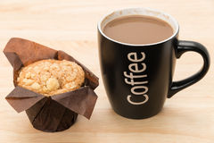 Coffee with a muffin Stock Photos